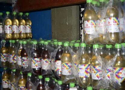 lote de las tres líneas de extracto en botella